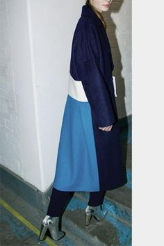 Signature REJINA PYO coat in navy melton wool coat with contrast back blue panel and white belt. Belt is removable. Oversized fit and half lined.