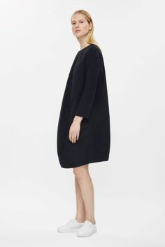 COS - This dress is made from a cotton-mix with a subtle sheen and curved seams across the body creating a concave shape. Fitted across the shoulder, it has long sleeves, a reverse graduated hemline and a hidden back zip. Wardrobe Sale, Small Wardrobe, Cocoon Dress, French Girls, Funky Fashion, Couture, Knit Dress, Street Wear, Cos