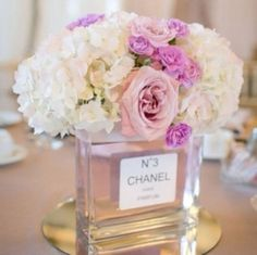 Chanel parfume bottle vase centerpiece