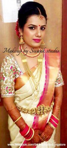 Our bride Aathmiya looks radiant for her muhurtam. Makeup and hairstyle by Swank Studio. Pink lips. Jhumkis. Maang tikka. Bridal jewelry. Bridal hair. Silk sari. Bridal Saree Blouse Design. Indian Bridal Makeup. Indian Bride. Gold Jewellery. Statement Blouse. Tamil bride. Telugu bride. Kannada bride. Hindu bride. Malayalee bride. Find us at https://www.facebook.com/SwankStudioBangalore