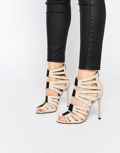 Heels by ASOS Collection Smooth leatherlook upper Elastic inserts Zip back  fastening High stiletto heel Wipe with a soft cloth Polyurethane Upper Heel