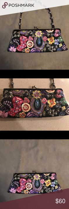 """LaRegale Black Evening Vintage Clutch La Regale vintage black satin beaded and embroidered evening bag/clutch bag. Attached to the frame is a beautiful beaded handle that can be tucked into the purse for a clutch look. Bag measures 9.5x4"""".  6"""" drop handle. Excellent condition! La Regale Bags Clutches & Wristlets"""