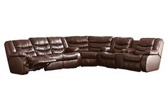 The Revolution - Burgundy Sectional from Ashley Furniture HomeStore (AFHS.com). Leather Match upholstery in Revolution leather, offers the luxurious look and feel of top quality leather with the benefit of protection.