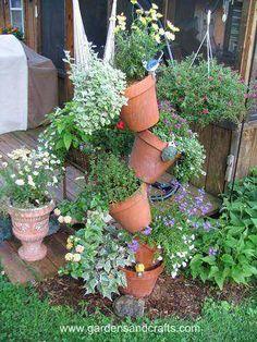 Tipsy Pots Plant Tower. Instructables.com via gardensandcrafts.