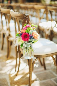 Use beautiful Farm Chairs with a padded cushion and mason jars filled with flowers and hung from the side for a beautiful wedding ceremony.