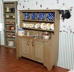 A view of the kitchen in the large Victorian dollhouse I am currently working on See more fabulous handmade scale miniatures at Small Scale Showcase Dish Cabinet, Liquor Cabinet, Miniature Furniture, Dollhouse Furniture, Victorian Dollhouse, Rustic Furniture, Dollhouse Miniatures, Dinnerware, Kitchen Cabinets