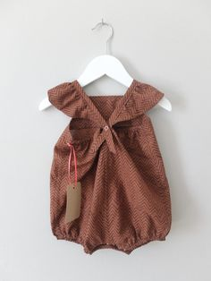 Inspired by my daughter and my background as a textile artist I have produced a range of alternative style baby clothes. I wanted to use designs and