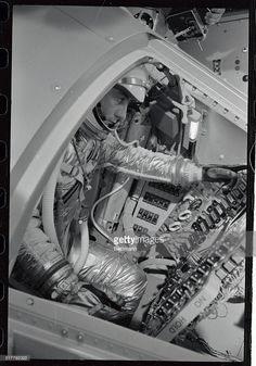 Astronaut Capt. Virgil Grissom, of the U.S. Air Force, tucked in a mock space capsule, makes a simulated space flight at the national aeronautics and space administration's space flight center here, September 15th. The seven astronauts held a press briefing at the new space center. Gus Grissom, Project Mercury, Lawrence County, Space Suits, Mission Control, Space Cowboys, Risky Business, Nasa Astronauts, Space Center