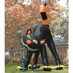 The Two Story Inflatable Black Cat - Hammacher Schlemmer - Standing nearly two stories tall, this inflatable black cat is the largest Halloween decoration available.