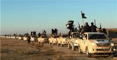 A convoy of vehicles belonging to the Islamic State drives through Iraq's Anbar Province on Jan. 7, 2014. AP