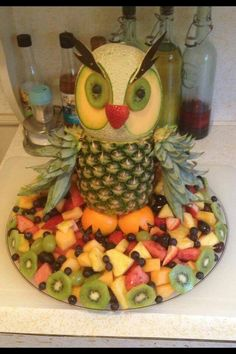Discover thousands of images about I couldn't find a fruit tray for an owl without the pineapple shell. Fruit used is red and white grapes, strawberries, and pineapple. Deco Fruit, Fruits Decoration, Fruit Creations, Food Carving, Watermelon Carving, Food Garnishes, Garnishing, Snacks Für Party, Owl Party Food