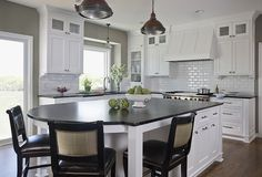 Wall color, white cabinets, black counter tops, hardwood floors, subway tile