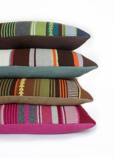 stacked view of alpaca frazada pillows backed with belgium linen