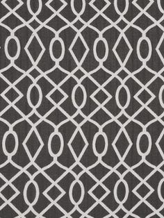 Encourage Fabric A woven fabric with a circular geometric design in silvery white on charcoal.