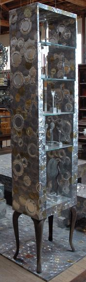 Tin Can shelving unit by artist Clare Graham, who repurposes tin cans,scrabble pieces and everyday items into art.