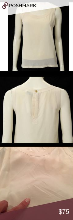 """Chanel Boutique Vintage Cream Silk Blouse Gorgeous and chic vintage cream silk Chanel Boutique Blouse. Features a back button closure, with button inscribed Coco Chanel Paris France. Small spot on front (see last picture) and light west on button finish. Otherwise great condition! Size not listed, but measurements are: total length: 24"""", cross chest: 17.5"""", cross back: 14"""", shoulder: 2"""". CHANEL Tops"""