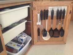 I bought some Command clear utensil hooks and organized everything I need inside a cabinet door of the pop-up. I bought these at Target and Kmart.