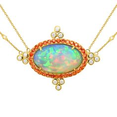 Watch the video in the link, it is incredible!  This award-winning 18K Gold Necklace by Yael Jewelry features an awe-inspiring 15.52CTW Crystal Opal accented by 1.97CTW Fire Opals and 0.72CTW Diamonds