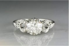 Antique 1910s-1920s Edwardian Engagement Ring with 1.65 Carat Old European Cut Diamond Center R719 by pebbleandpolish on Etsy https://www.etsy.com/listing/469494114/antique-1910s-1920s-edwardian-engagement