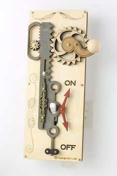 SteamPunk Light Switch Plate  this seller has some awesome things. I just wish it had metal elements as well.