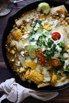 Chicken enchiladas loaded with fresh summer sweet corn, charred heirloom tomatoes, lots of pepperjack cheese and topped with the most amazing roasted tomatillo salsa ever. These are the ultimate summer time enchiladas!