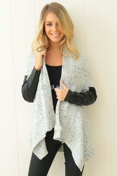 Silent Theory Waterfall Cardi in Light Grey $35.00  The contrast of the gentle and tough elements of the Silent Theory Cardigan brings out both soft and edgy element of the wearer. This cardigan is slightly loose fitting on the body with the cozy knitted shell which will keep the wearer warm. The sleeves however are more slim fitting and features edgy faux leather panels. It also features decorative zips on the sides of the front, where the waterfall collar falls over the wearer…