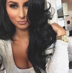 Long, layered haircut with inversion layers framing the face. Love the long black hair.