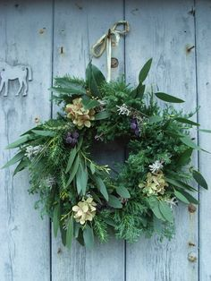 natural wreath with hydrangea dried flower and flat leaf eucalyptus