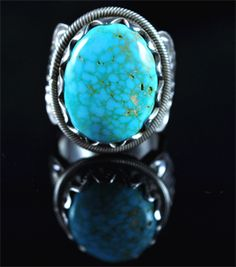 Handmade ring, with natural gem grade Candelaria Turquoise, by Navajo artist Donovan Cadman.