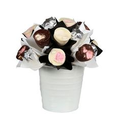 It doesn`t get much more indulgent than a bouquet full of delicious rocky road bites! Boasting a dozen of the delicious morsels in a classic black and white arrangement. Includes: 6 white chocolate rocky road flowers from Inspired, 6 dark chocolate rocky road flowers from Inspired, 6 solid Belgian milk chocolates from Chocolatier, Keepsake white bucket, Complimentary gift wrapping and gift card.