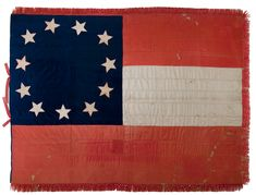 This silk Confederate 1st National pattern flag has two red stripes, one white stripe and a blue field, with eleven white stars outlined in red. The 1st National flag was presented to the Provisional Congress of the Confederate States of American by a flag committee on March 4, 1861. From the Trans Mississippi Virtual Museum