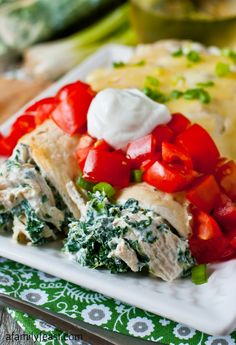 Skinny Creamy Chicken Enchiladas ~ Says: boneless skinless chicken breast and cooked spinach that has been tossed with a light and super flavorful combination of low-fat sour cream, Chobani fat-free Greek yogurt, scallions, cumin & some diced green chili peppers. After they are baked, some reduced-fat cheddar or Monterey Jack cheese is sprinkled over the top until it melts. Garnished with fresh tomatoes, chopped scallions, and a dollop of yogurt
