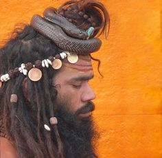 Sadhu with cobra and rudraksha. Channeling his inner Shiva