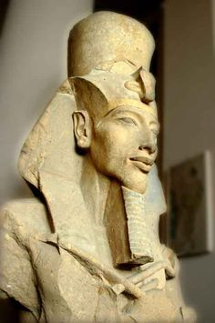 Colossal Statue of Akhenaten - Karnak, Egypt (ca. 1350 BCE). The heretic king who revolutionized Egypt\'s religion to revolve around the sun disc (the Aten), moved the capital to the virgin city of Amarna, and distorted the artistic canon to depict elongated and androgynous figures.