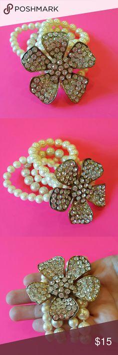 Rhinestone Flower Faux Pearl Bracelet Stretchy bracelet with a rhinestone studded flower & faux pearls.  Comes from a smoke free home! I always ship same or next day :) Jewelry Bracelets