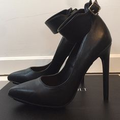 Nasty Gal Sexy black pumps heels size 6 Sexy black pumps with adjustable belted ankle strap. 3-4 inch heel. Worn only once for a couple hours, no wear or tear. Looks brand new! I love these but they're not fitting my style any more. Comes with box and fabric shoe holder Nasty Gal Shoes Heels
