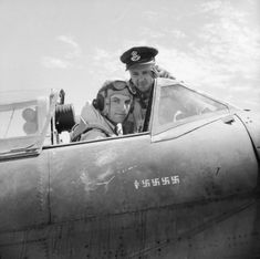 MAY 21 1942 Spitfire vs Messerschmitt 109 over Malta Denis Barnham in Spitfire Flight Lieutenant Dennis Barnham, flight commander of No. 601 Squadron RAF, in the cockpit of his Supermarine Spitfire Mark VB at Luqa, Malta, at a time when his victory tally was five enemy aircraft. Pilot Officer M H Le Bas looks on.