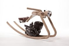 This fantastic creation is from German designer Felix Götze, who has created this rocking horse from old motorcycle parts. Apparently it's for a little kid who is fascinated by choppers coming out of a workshop opposite his house. It also features pinstripe detail by artist Thomas Weber.
