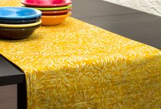 Looking for modern table linens? We've created a wide range of reversible batik fabric table runners for your home or office. Add a splash of color to your dining table, dresser, credenza or coffee ta