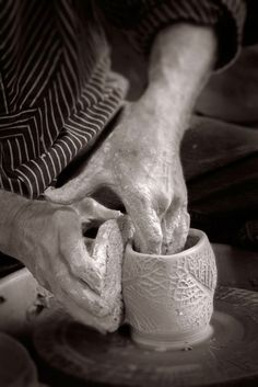 Jack Troy texturing the side of a cup with a stamp