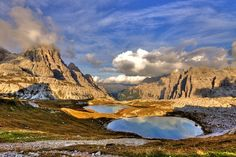 """The three peaks of Lavaredo, or the """"Tre Cime di Lavaredo"""" in Italian, are three distinctive battlement-like peaks, in the Sexten Dolomites . Royal Caribbean, Destinations, Monument Valley, Planets, Places To Go, Water, Travel, Outdoor, Landscape"""