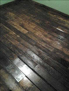 Pallet flooring - I took pallets apart, sanded and stained and here we have it!  Wood flooring that is beautiful!