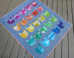 The Cat Quilt by Elizabeth Hartman. I'm thinking I'm going to make these in a row, for the side of my Petal Panache cushion... the cats would love it!