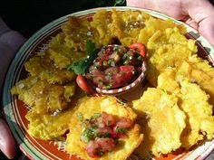 Patacones (Deep Fried Plantains) with Pico de Gallo (fresh salsa) ~ A popular coastal Costa Rican snack is the patacone (plural patacones). Green plantains are peeled, sliced, and fried briefly in oil. They are then squashed flat, and fried a second time until golden and delicious. #Costa_Rica #Food #Plantain #Patacones