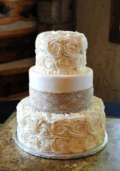 burlap and rosette wedding cake / http://www.deerpearlflowers.com/rustic-country-burlap-wedding-cakes/2/
