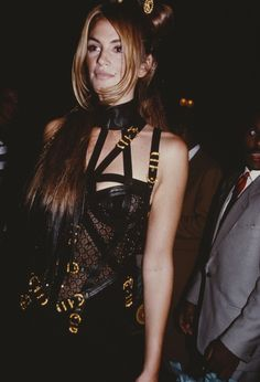 Cindy Crawford wears a lace bodysuit and Versace bondage in 1992