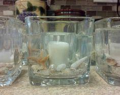 Arena de conchas de mar burbujas candelero