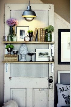 Repurpose an aged door with shelving --great for small space design and adds instant function and character.