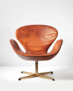 Arne Jacobsen Swan swivel chair, 1958. Leather, bronze. Manufactured by Fritz Hansen, Denmark.