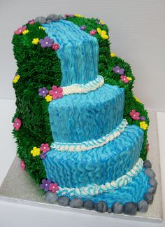 The groom wanted a waterfall with dock and wood on the cake and the bride wanted a square brown floral cake.